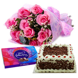 Delicious Fresh Cake with Pink Rose Arrangement and Cadbury Celebration