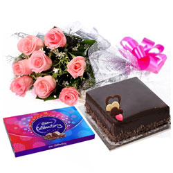Festive Feast of Cake, Pink Rose Bouquet and Cadbury Celebration