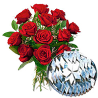 Gorgeous 12 Red Roses with toothsome 500 Gms. Kaju Barfi delight