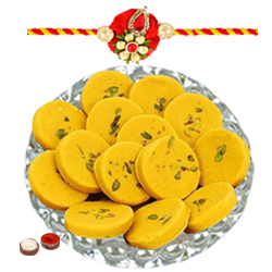 Dazzling Combination of Rakhi and Kesar Pedas with Roli Tilak N Chawal for Caring Brother