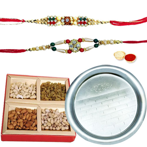 Flattering Gift Set of Pooja Thali N Assorted Dry Fruits with 2 free Rakhi, Roli Tilak and Chawal for your Precious Brother on the Occasion of Rakhi
