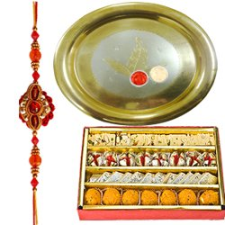 Graceful Gift of Gold Plated Puja Thali and Assorted Sweets from Haldiram with Free Rakhi, Roli Tilak and Chawal for your Lovely Siblings